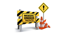 Caution yellow sign with a orange construction cone saying: Website Under Construction