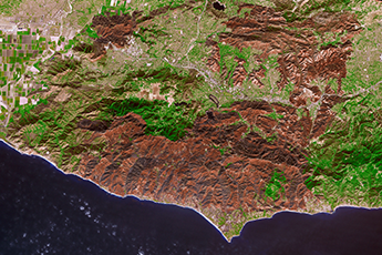 False color Terra satellite image shows burn scars from Woolsey Fire.
