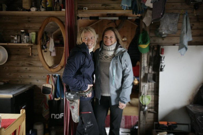 Hilde Fålun Strøm (left) and Sunniva Sorby (right) inside the trapper cabin 'Bamsebu' in Svalbard, Norway.